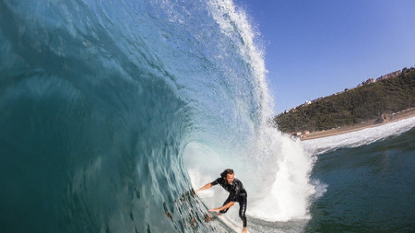 41230629 - surfing surfer rides inside blue large hollow crashing ocean wave a swimming water photo closeup of action.