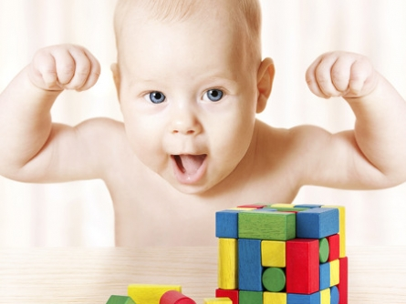 37671591 - smart baby playing toy blocks, strong healthy child laughing, hand raise up, little kids success early development and activity concept, jigsaw puzzle game