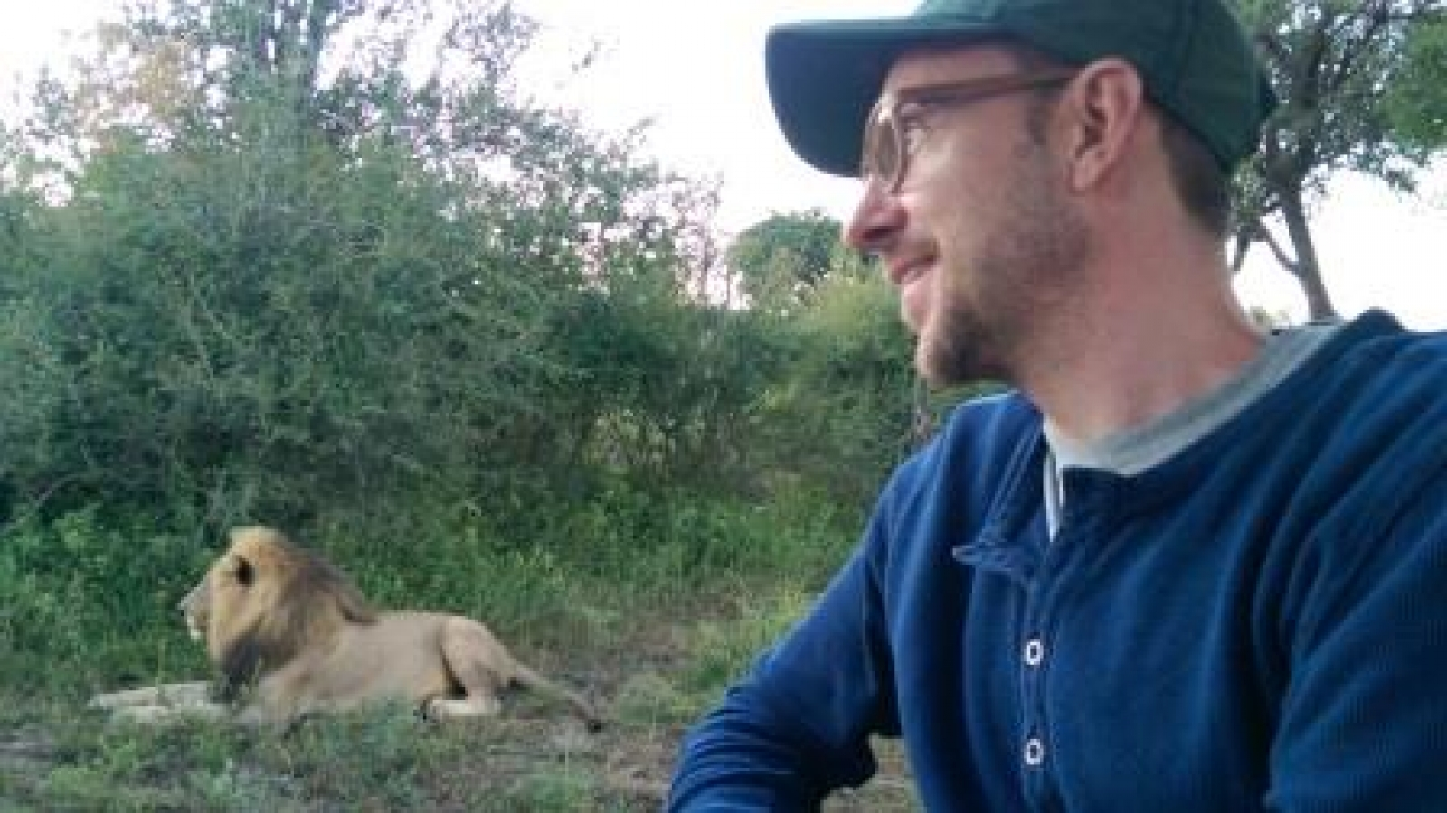Tim w Lion in S. Africa_compressed